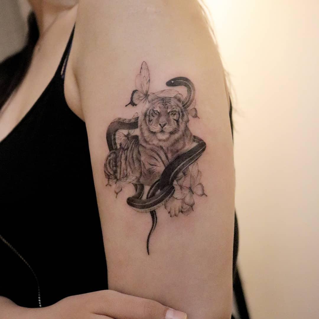 Lion & Snake Illustrative Tattoos