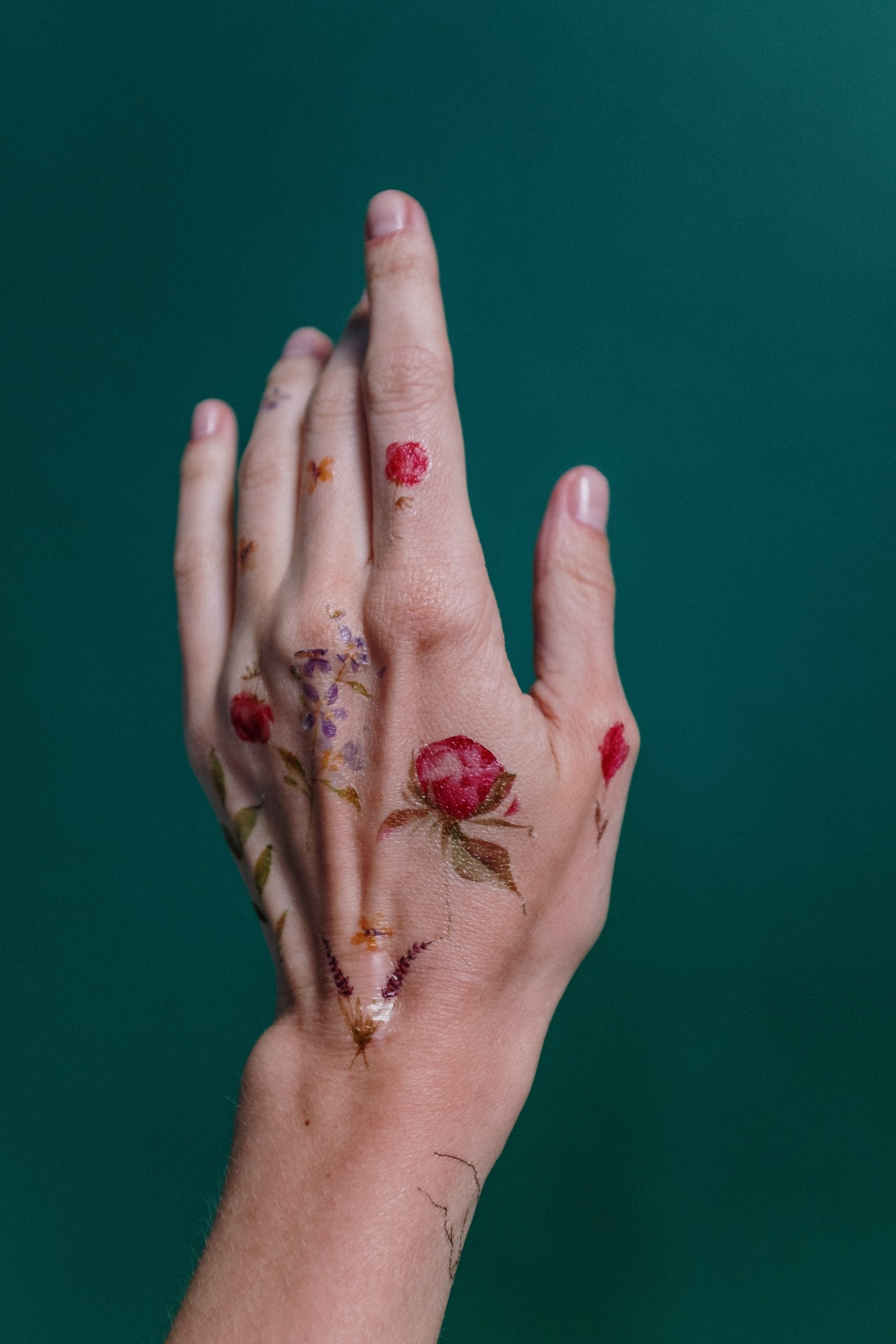 hand with floral tattoos