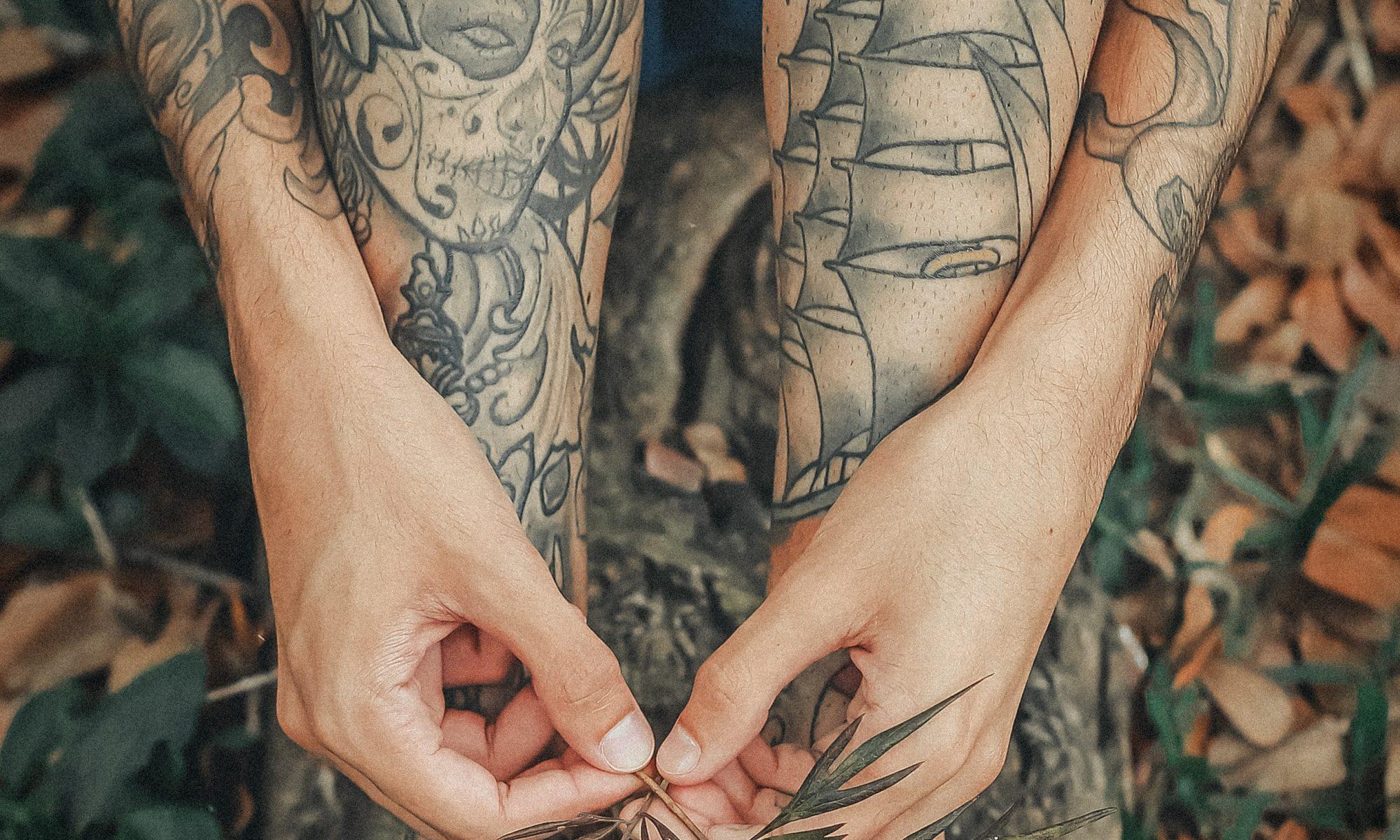 tattooed women holding leaves