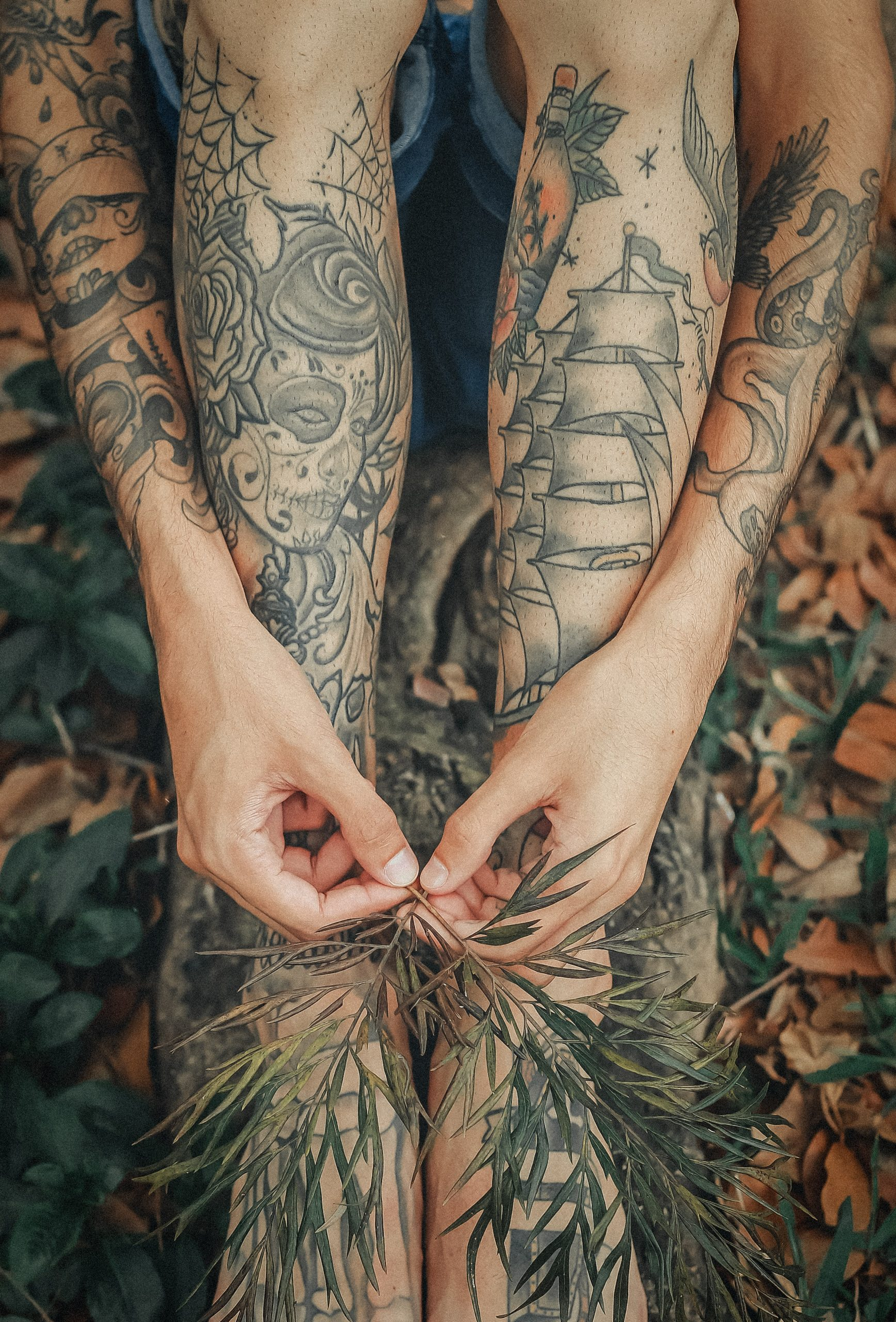 tattooed women holding leaves